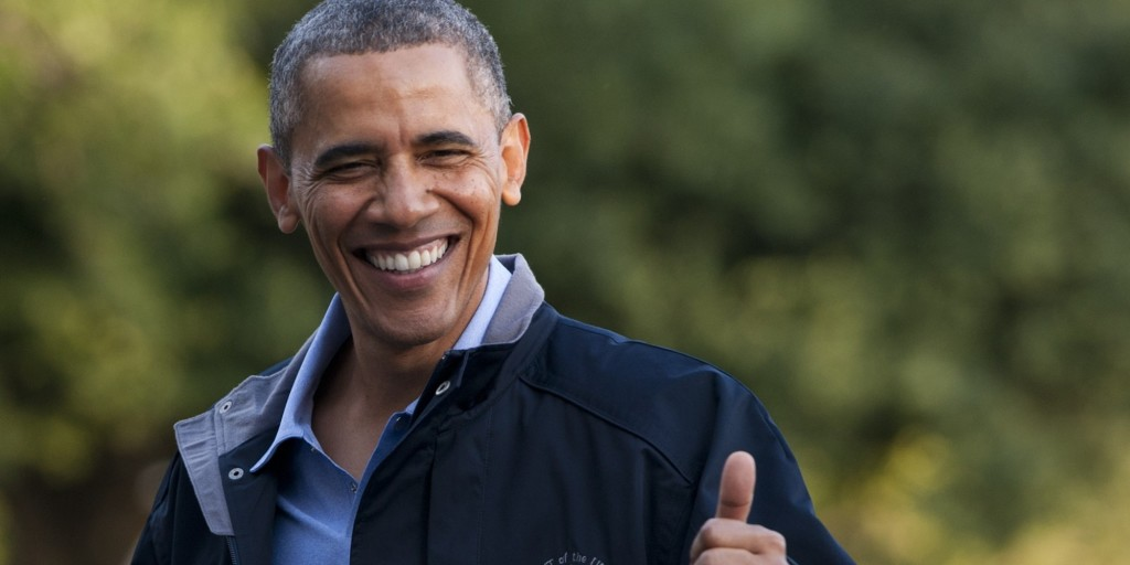 US President Barack Obama gives a thumbs-up as he walks from Marine One upon arrival on the South Lawn of the White House in Washington, DC, July 26, 2013, after returning from Camp David where he attended a retreat with members of his Cabinet. AFP PHOTO / Saul LOEB (Photo credit should read SAUL LOEB/AFP/Getty Images)