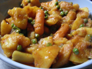 saucy sweet potatoes with peas and carrots2